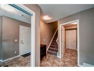 Photo 4: 113 WINDSTONE Mews SW: Airdrie House for sale : MLS®# C4016126