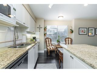 "Photo 11: 210 20120 56 Avenue in Langley: Langley City Condo for sale in ""BLACKBERRY LANE"" : MLS®# R2531152"