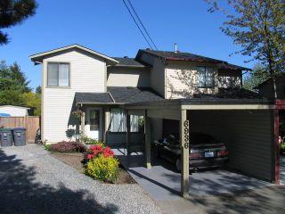 """Photo 1: 6936 134 ST in Surrey: West Newton 1/2 Duplex for sale in """"Bentley"""" : MLS®# F1309630"""