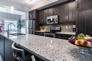 Photo 9: 374 Nolancrest Heights NW in Calgary: Nolan Hill Row/Townhouse for sale : MLS®# A1145723