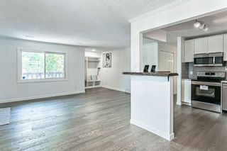 Photo 12: 15 Cedar Spring Gardens SW in Calgary: Cedarbrae Row/Townhouse for sale : MLS®# A1103133