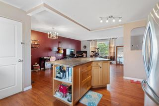 Photo 8: 1418 41 Street SW in Calgary: Rosscarrock Detached for sale : MLS®# A1130231