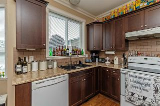 """Photo 15: 34745 3RD Avenue in Abbotsford: Poplar House for sale in """"HUNTINGDON VILLAGE"""" : MLS®# R2580704"""