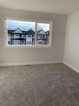 Photo 10: 1052 Lanark Boulevard SE: Airdrie Row/Townhouse for sale : MLS®# A1052705
