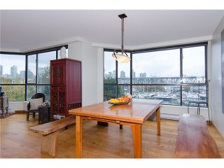 "Photo 33: 202 1490 PENNYFARTHING Drive in Vancouver: False Creek Condo for sale in ""HARBOUR COVE"" (Vancouver West)  : MLS®# V977927"