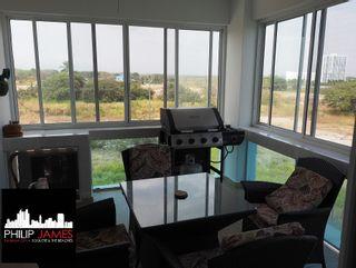 Photo 7: Playa Blanca Resort $174,900