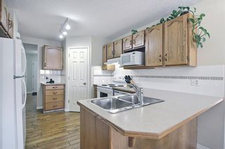 Photo 13: 154 WEST CREEK Bay: Chestermere Semi Detached for sale : MLS®# A1077510