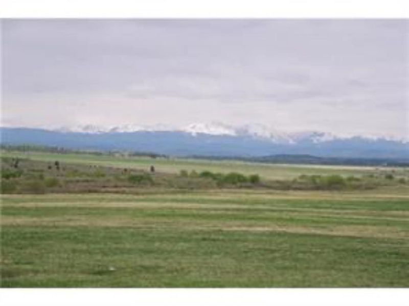 FEATURED LISTING: 242255 Windhorse Way Rural Rocky View County