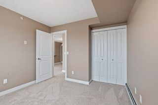 Photo 17: 7411 403 Mackenzie Way SW: Airdrie Apartment for sale : MLS®# A1152134