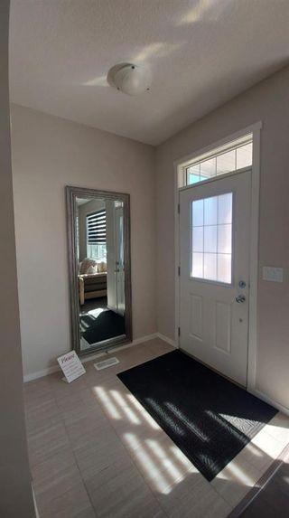 Photo 7: 110 Auburn Meadows Avenue SE in Calgary: Auburn Bay Semi Detached for sale : MLS®# A1095114