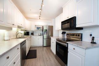 """Photo 8: 301S 1100 56 Street in Delta: Tsawwassen East Condo for sale in """"ROYAL OAKS"""" (Tsawwassen)  : MLS®# R2621715"""