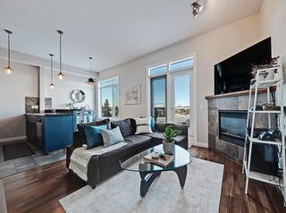 Photo 2: 404 2 HEMLOCK Crescent SW in Calgary: Spruce Cliff Apartment for sale : MLS®# A1061212