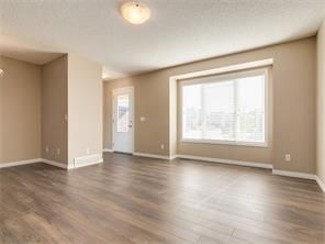 Photo 8: 4052 Windsong Boulevard SW in Airdrie: windsong House for sale : MLS®# C4120616