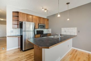 Photo 8: 8 Everridge Gardens SW in Calgary: Evergreen Row/Townhouse for sale : MLS®# A1041120