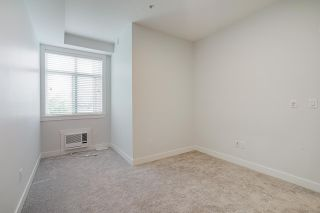 """Photo 11: 418 20696 EASTLEIGH Crescent in Langley: Langley City Condo for sale in """"The Georgia"""" : MLS®# R2574305"""