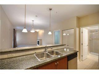 Photo 3: 315 100 CAPILANO Road in Port Moody: Port Moody Centre Condo for sale : MLS®# V985603