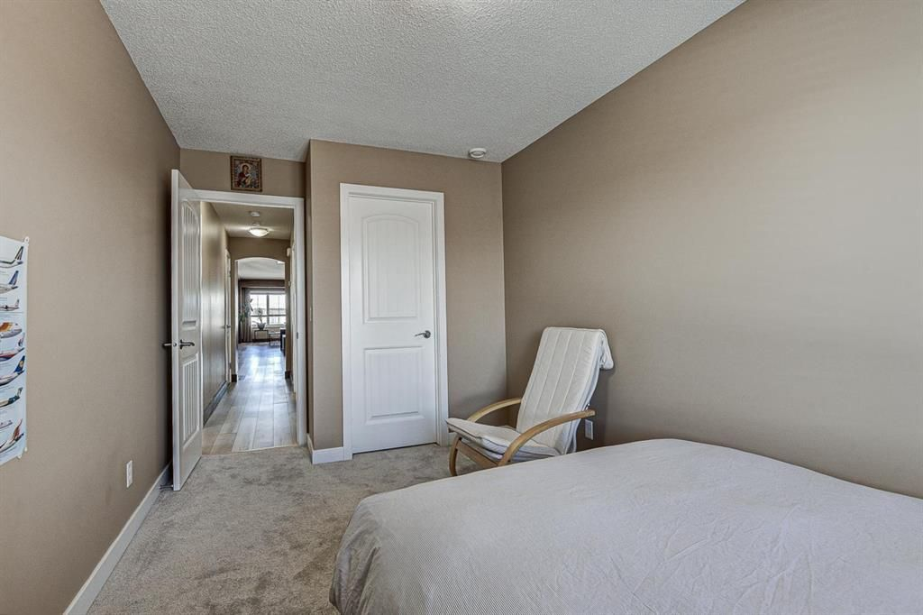 Photo 24: Photos: 230 EVERSYDE Boulevard SW in Calgary: Evergreen Apartment for sale : MLS®# A1071129