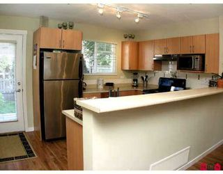 """Photo 2: 35 6651 203RD Street in Langley: Willoughby Heights Townhouse for sale in """"Sunscape"""" : MLS®# F2719428"""