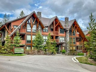 Photo 1: 303 2100A Stewart Creek Drive: Canmore Apartment for sale : MLS®# A1113991