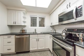 Photo 1: 8033 CHAMPLAIN Crescent in Vancouver: Champlain Heights Townhouse for sale (Vancouver East)  : MLS®# R2121934