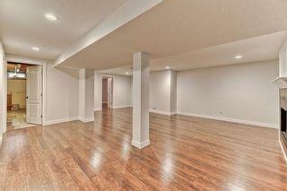 Photo 18: 316 Queen Alexandra Road SE in Calgary: Queensland Detached for sale : MLS®# A1104461