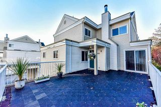 """Photo 1: 105 10091 156 Street in Surrey: Guildford Townhouse for sale in """"Guildford Park"""" (North Surrey)  : MLS®# R2321879"""