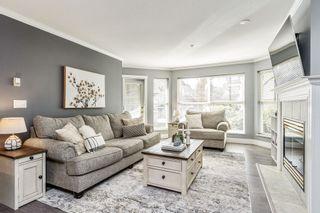 "Photo 3: 101 6557 121 Street in Surrey: West Newton Condo for sale in ""Lakewood Terrace"" : MLS®# R2554164"