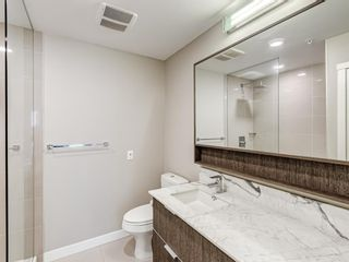 Photo 18: 216 823 5 Avenue NW in Calgary: Sunnyside Apartment for sale : MLS®# A1078604