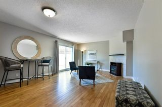 Photo 7: 1301 829 Coach Bluff Crescent in Calgary: Coach Hill Row/Townhouse for sale : MLS®# A1094909