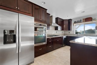 Photo 8: RANCHO SAN DIEGO House for sale : 4 bedrooms : 1542 Woody Hills Dr in El Cajon