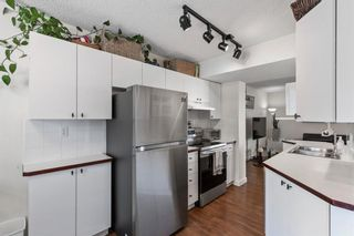 Photo 7: 102 4810 40 Avenue SW in Calgary: Glamorgan Row/Townhouse for sale : MLS®# A1136264
