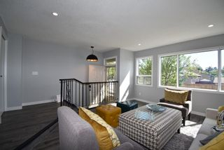 Photo 2: 5 903 67 Avenue SW in Calgary: Kingsland Row/Townhouse for sale : MLS®# A1115343