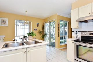"""Photo 5: 104 16275 15 Avenue in Surrey: King George Corridor Townhouse for sale in """"SUNRISE POINT"""" (South Surrey White Rock)  : MLS®# R2303886"""
