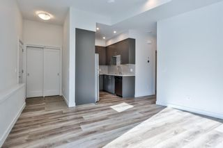 Photo 2: 102F 1200 Three Sisters Parkway: Canmore Row/Townhouse for sale : MLS®# A1056458