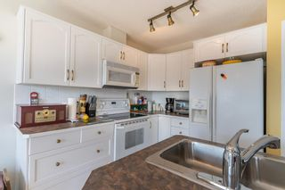 Photo 13: 112 Rocky Vista Circle NW in Calgary: Rocky Ridge Row/Townhouse for sale : MLS®# A1125808