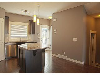 Photo 6: 452 Rainbow Falls Drive: Chestermere Townhouse for sale : MLS®# C3579282
