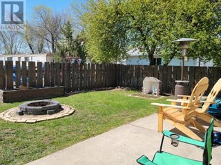 Photo 10: 91 Greenbrook Drive E in Brooks: House for sale : MLS®# A1100776