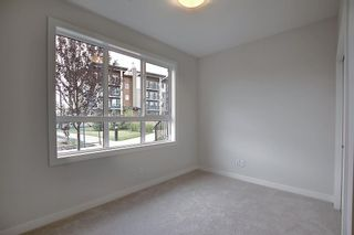 Photo 10: 65 Walgrove Plaza SE in Calgary: Walden Row/Townhouse for sale : MLS®# A1069539