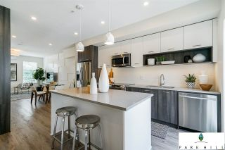 """Photo 1: 7 20087 68 Avenue in Langley: Willoughby Heights Townhouse for sale in """"PARK HILL"""" : MLS®# R2315317"""