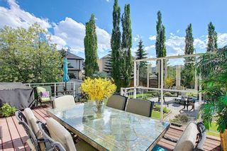 Photo 12: 31 Strathlea Common SW in Calgary: Strathcona Park Detached for sale : MLS®# A1147556
