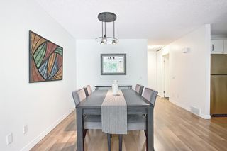 Photo 12: 14 Point Mckay Crescent NW in Calgary: Point McKay Row/Townhouse for sale : MLS®# A1130128