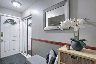Photo 4: 4 Rossburn Crescent SW in Calgary: Rosscarrock Detached for sale : MLS®# A1073335