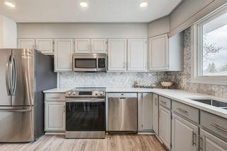 Photo 11: 216 Pinecrest Crescent NE in Calgary: Pineridge Detached for sale : MLS®# A1098959