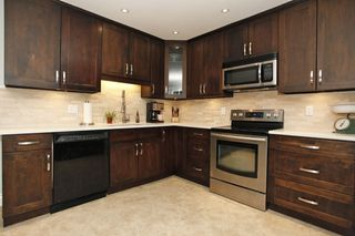 """Photo 5: 3496 198 Street in Langley: Brookswood Langley House for sale in """"Meadowbrooke"""" : MLS®# R2168716"""