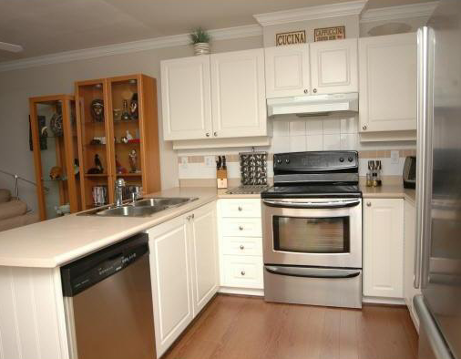 Main Photo: 410 1591 Booth Avenue in Coquitlam: Maillardville Condo for sale : MLS®# v932261