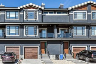 Main Photo: 947 38 Street SW in Calgary: Rosscarrock Row/Townhouse for sale : MLS®# A1144379