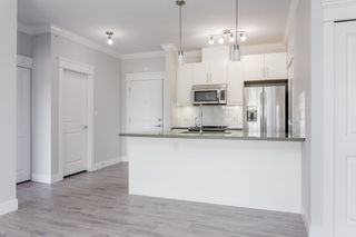 """Photo 1: 405 2229 ATKINS Avenue in Coquitlam: Central Pt Coquitlam Condo for sale in """"Downtown Pointe"""" (Port Coquitlam)  : MLS®# R2440972"""