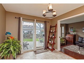 """Photo 3: 103 5641 201 Street in Langley: Langley City Townhouse for sale in """"THE HUNTINGTON"""" : MLS®# R2537246"""