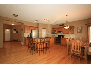 Photo 7: 18 WEST POINTE Manor: Cochrane House for sale : MLS®# C4072318