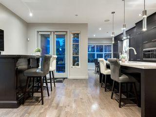 Photo 12: 408 Aspen Meadows Hill SW in Calgary: Aspen Woods Row/Townhouse for sale : MLS®# A1143107